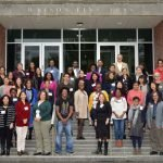 Faculty of Color Workshop 2019. Photo of all participants posing for pictures on the main front steps of a building.